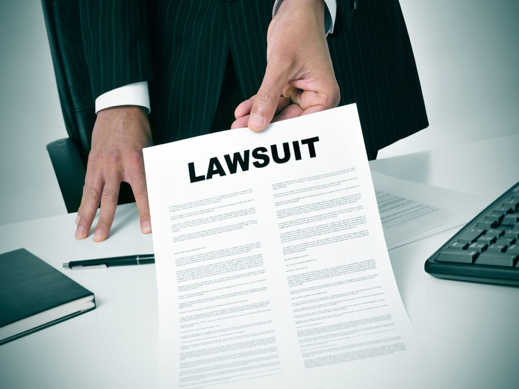 ADA Correct Website Remediation Services Background Image of a Hand Serving a Lawsuit Letter