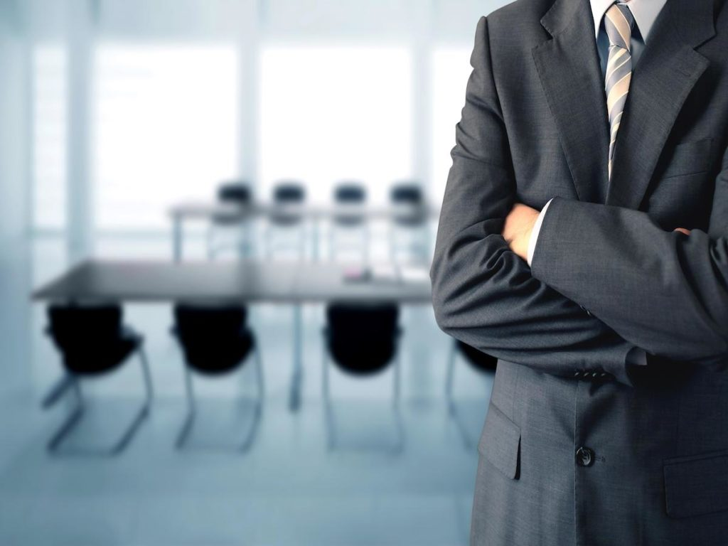 ADA Correct Website Remediation Services Background Image of a Businessman in a Conference Room